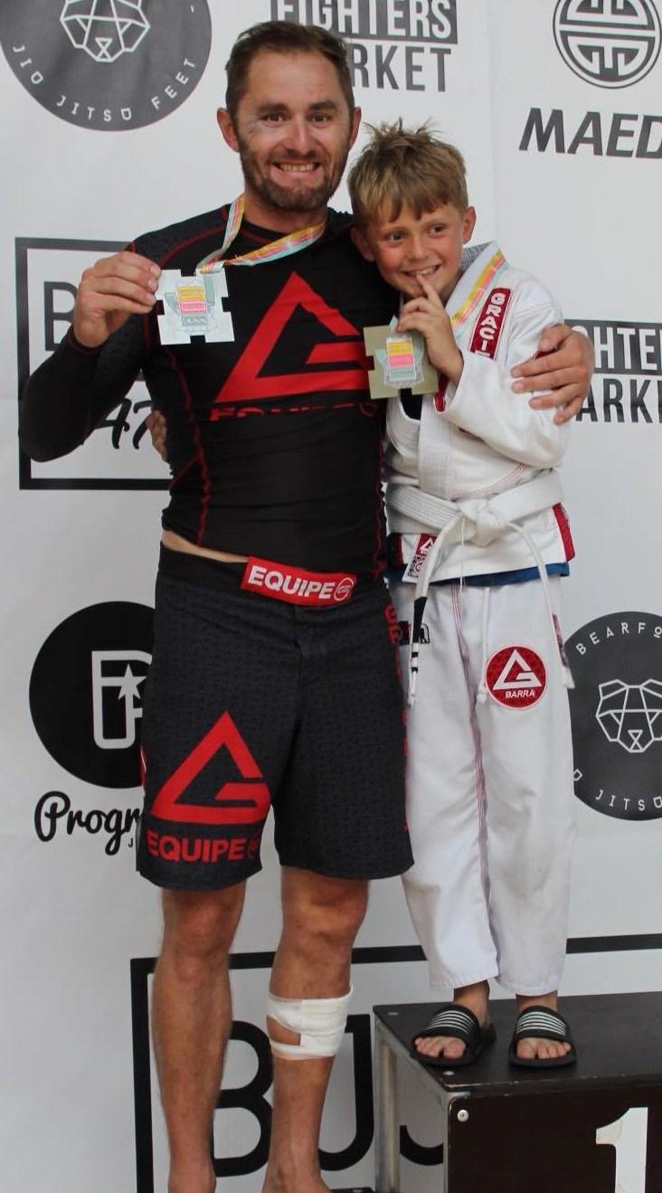 james-boardman-and-son-bailey-with-their-brighton-open-medals-copy-e1535623787342.jpg